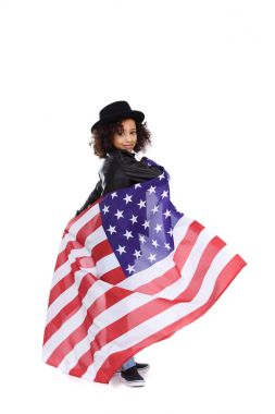 happy little child in stylish hat with usa flag isolated on white