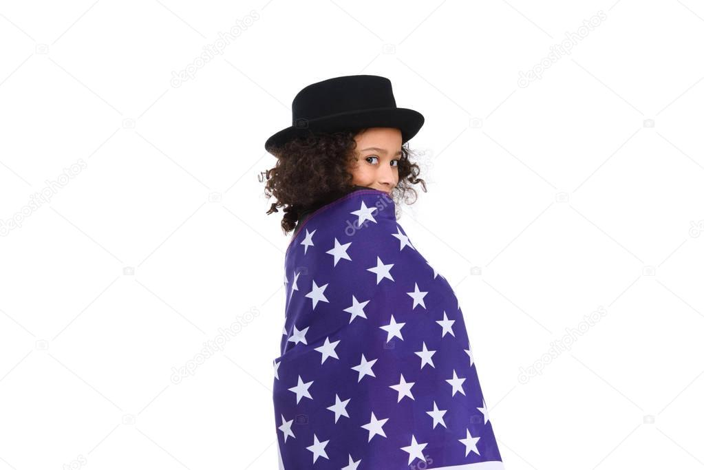 funny little child in hat covered in usa flag isolated on white