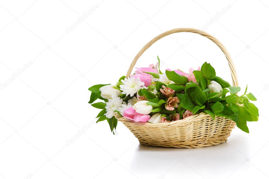close-up shot of beautiful flowers in basket isolated on white