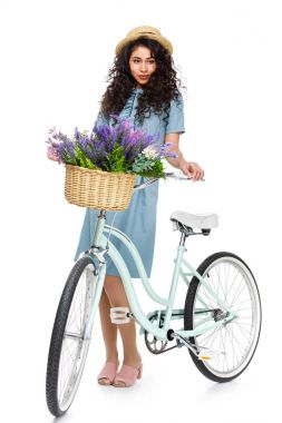 Attractive young woman with bicycle isolated on white stock vector