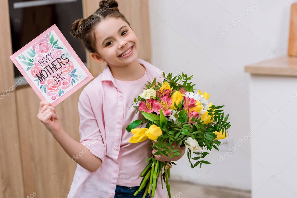 adorable little child with with bouquet and mothers day greeting card