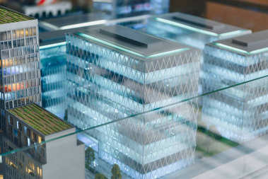 miniature model of modern city under glass