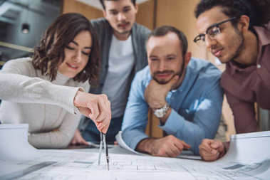 Close-up shot of group of architects drawing building plan together at office stock vector