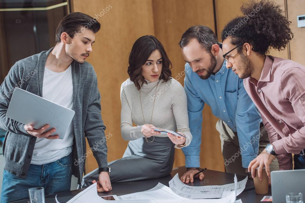 group of successful architects working together at modern office