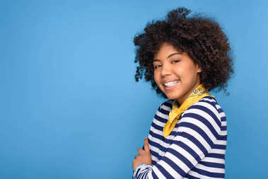 cheerful african american young girl, isolated on blue