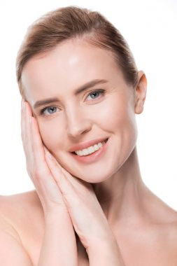 Portrait of female with clean skin touching own face isolated on white