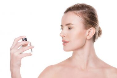 Side view of woman with perfume isolated on white