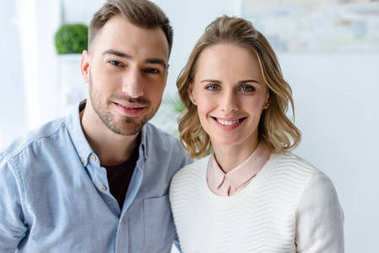 Smiling young couple in casual clothes