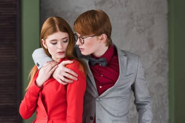 Young couple of fashion models dressed in jackets