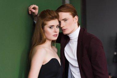 Portrait of fashion models couple dressed in formal wear
