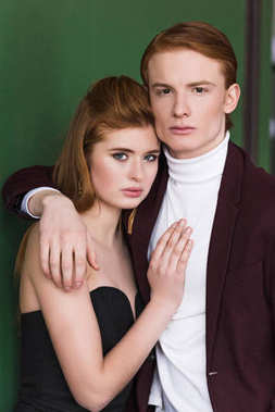 Portrait of couple young fashion models dressed in formal wear