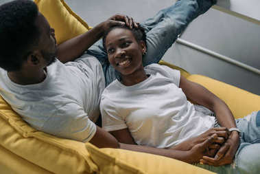 high angle view of happy young african american couple spending time together at home