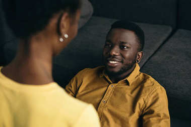 selective focus of happy young african american couple spending time together at home