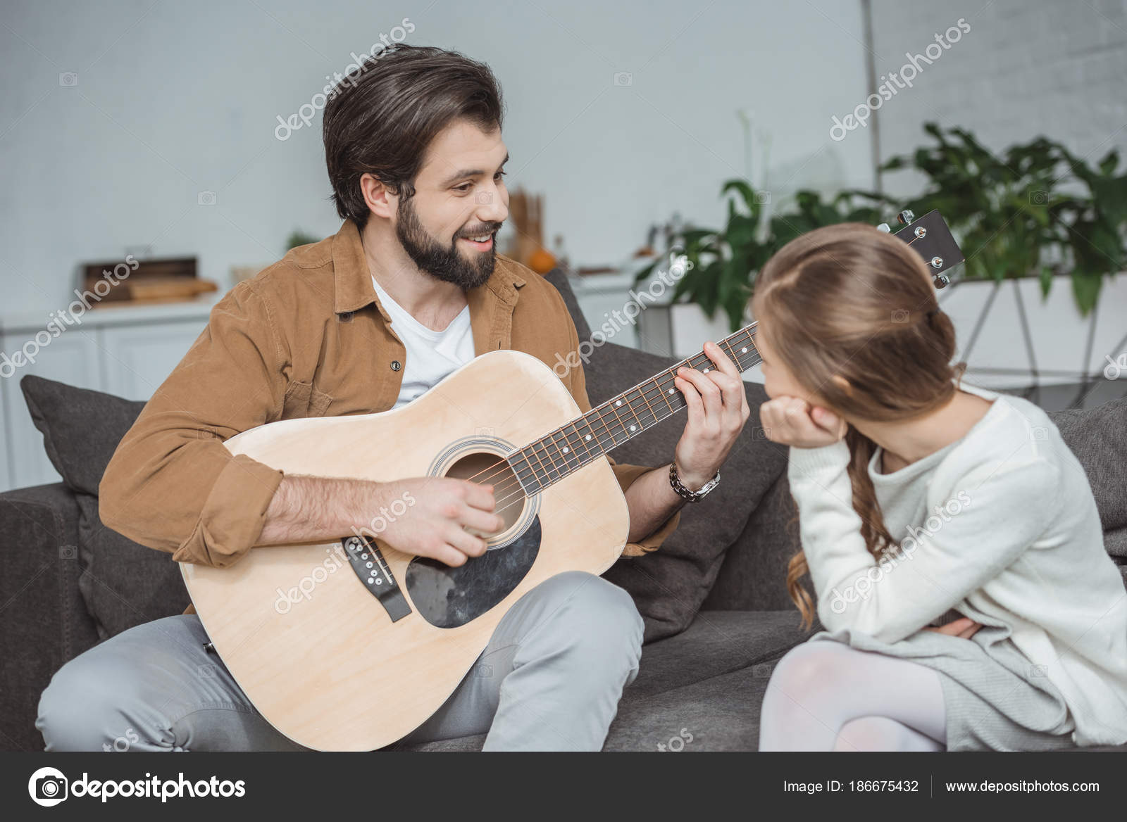 Smiling Father Showing Daughter How Play Barre Chord Stock Photo
