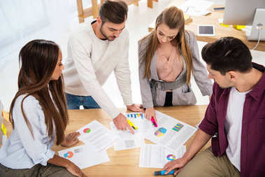 Multiethnic business colleagues discussing new marketing project at workplace in office stock vector