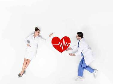 Creative collage of male and female doctors with heartbeat sign on white stock vector