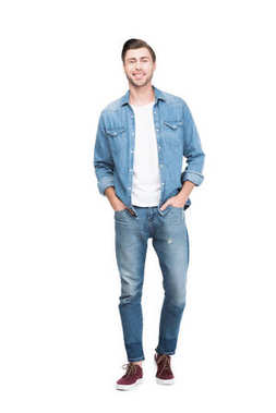 Young smiling man in jeans looking at camera, isolated on white stock vector