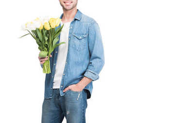 cropped view of man holding bouquet of tulips, isolated on white