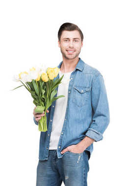 smiling man holding bouquet of tulips, isolated on white