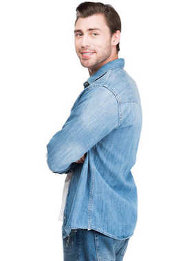 young man in denim smiling at camera, isolated on white
