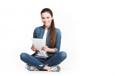 beautiful cheerful girl using tablet, isolated on white