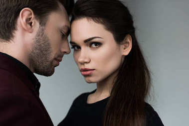 beautiful sensual couple, isolated on grey