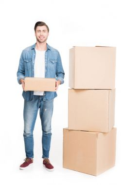 happy young man with cardboard boxes, isolated on white