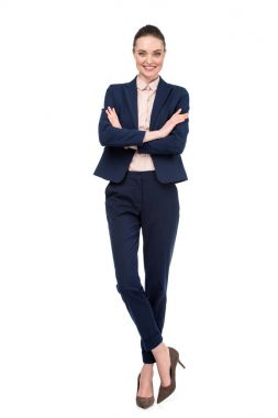 stylish adult businesswoman with crossed arms isolated on white