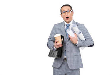 shocked overworked businessman with rolls of paperwork and coffee isolated on white