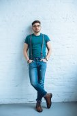 Bearded young man wearing t-shirt and jeans