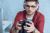 Fotografie Young photographer holding digital camera in light office
