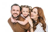 Fotografie happy parents with adorable little daughter smiling at camera isolated on white
