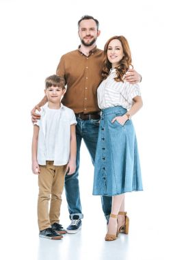 full length view of happy family with one child standing together and smiling at camera isolated on white
