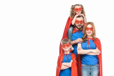 happy super family in masks and cloaks smiling at camera isolated on white