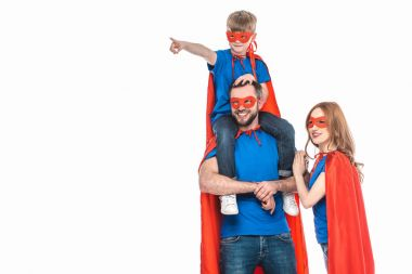 super family in masks and cloaks smiling and looking away isolated on white