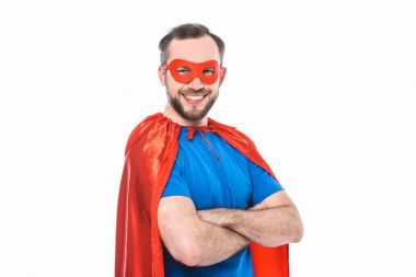 handsome bearded man in superhero costume standing with crossed arms and smiling at camera isolated on white