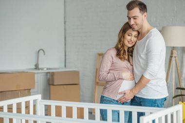 pregnant couple moving