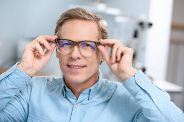 Portrait of middle aged man in glasses looking at camera stock vector