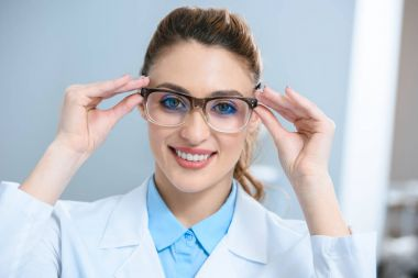 attractive smiling ophthalmologist wearing eyeglasses