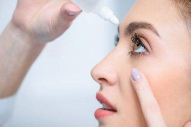 Profile of beautiful woman dripping eye drops stock vector