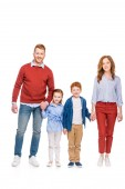 happy redhead family with two kids holding hands and smiling at camera isolated on white