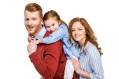 Fotografie happy parents with cute little daughter smiling at camera isolated on white