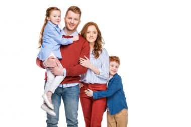 beautiful happy redhead family with two children smiling at camera isolated on white