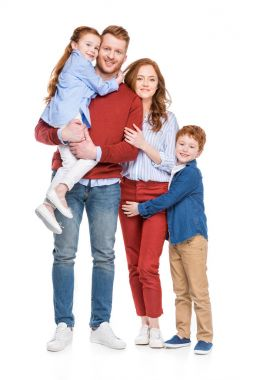 beautiful happy family with two children smiling at camera isolated on white