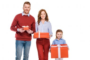 happy redhead family holding gift boxes and smiling at camera isolated on white
