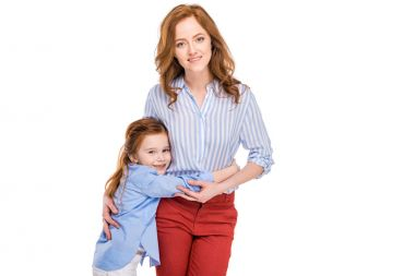 beautiful happy mother and daughter hugging and smiling at camera isolated on white