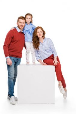 beautiful happy redhead family with one child smiling at camera isolated on white