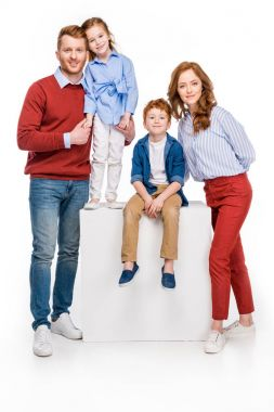 full length view of happy red haired family smiling at camera isolated on white