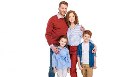 Happy red haired family with two kids standing together and smiling at camera isolated on white stock vector