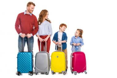 Happy redhead family standing with colorful suitcases isolated on white stock vector